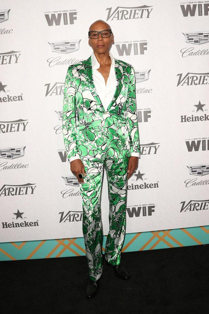 <p>Ru is no shrinking wall flower in this foliage-like suit at the Variety And Women In Film's 2018 Pre-Emmy Celebration.</p>