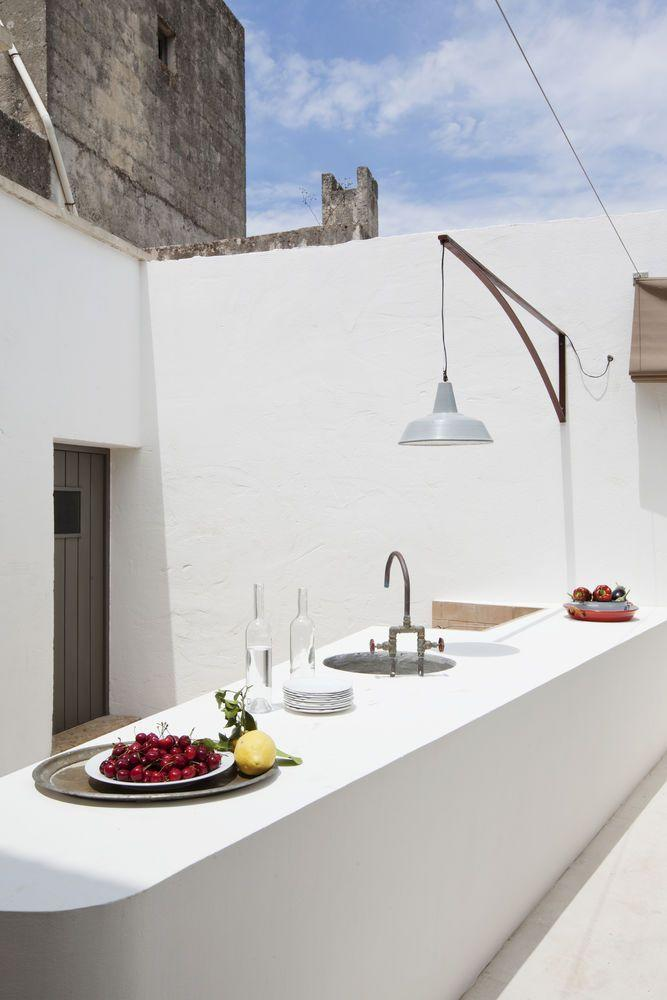 <p>Move over barbecues, outdoor kitchens are on the rise. Sharp edges and clean lines are the secret to the success of this sleek design, painted white so as to minimise its impact in what is a relatively small space. A good outdoor kitchen should include a sink, cooker, fridge and waste bin – and don't forget lighting if you plan to use it after dark.</p>