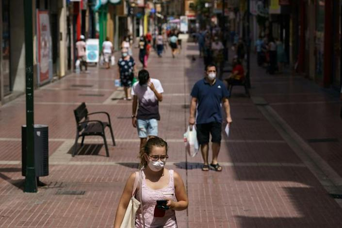 """Infections have surged since early July, some blaming the government or """"rushing"""" to restart Spain's vital tourism industry"""