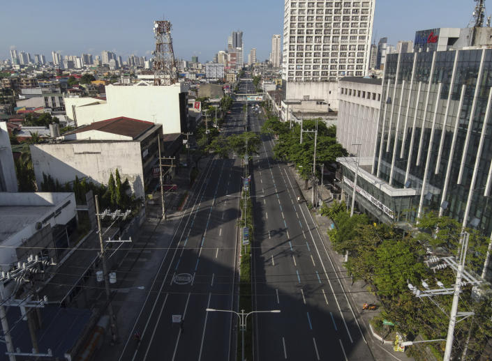 An almost empty Espana boulevard as the government implements a strict lockdown to prevent the spread of the coronavirus on Good Friday, April 2, 2021 in Manila, Philippines. Filipinos marked Jesus Christ's crucifixion Friday in one of the most solemn holidays in Asia's largest Catholic nation which combined with a weeklong coronavirus lockdown to empty Manila's streets of crowds and heavy traffic jams. Major highways and roads were eerily quiet on Good Friday and churches were deserted too after religious gatherings were prohibited in metropolitan Manila and four outlying provinces. (AP Photo/Aaron Favila)