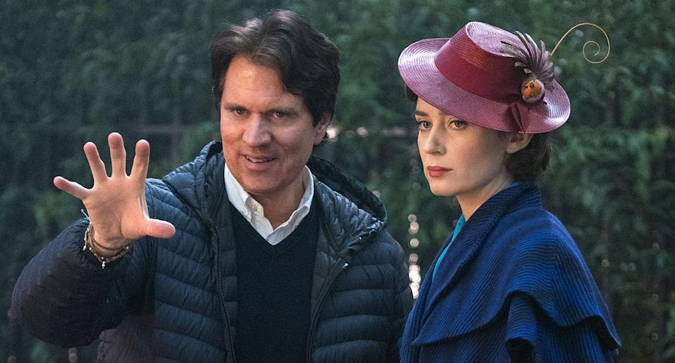 Emily Blunt receives instructions from director Rob Marshall on the set of <i>Mary Poppins Returns</i>. (Disney)