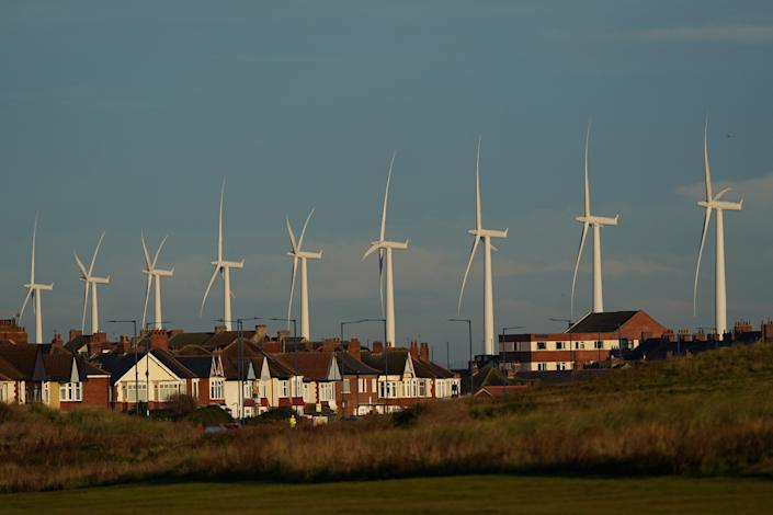An offshore wind farm towers over the homes of Redcar, England.  Prime Minister Boris Johnson wants the UK to become