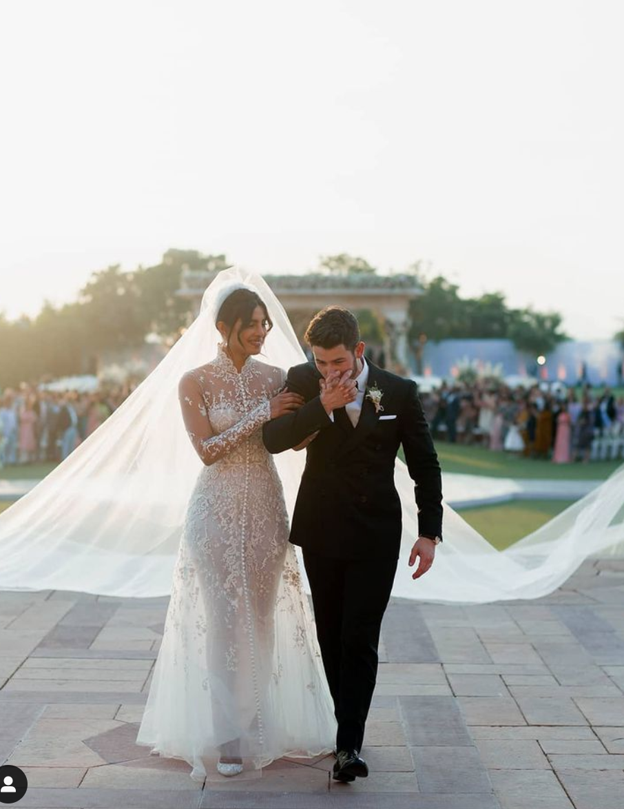 <p>Priyanka Chopra and Nick Jonas tied the knot with multiple breath-taking ceremonies held in Mumbai, India and Jodhpur, India. For the Christian ceremony, Priyanka wore this custom Ralph Lauren wedding dress paired with a 75-foot long veil. Chopra also donned designs by Sabyasachi, Dior, and more for the couple's various other celebrations.</p>