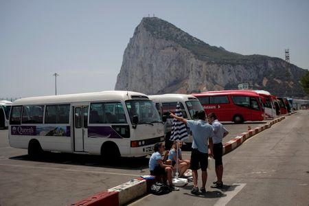 Workers of a bus for tourists wait for clients at the border of Gibraltar with Spain in front of the rock in the British overseas territory of Gibraltar, historically claimed by Spain, June 24, 2016, after Britain voted to leave the European Union in the EU BREXIT referendum. REUTERS/Jon Nazca
