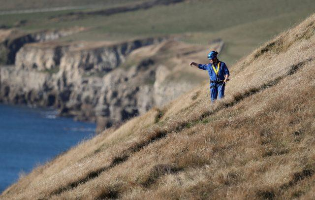 Search and rescue teams perform a search on the cliffs above the coast near to Swanage