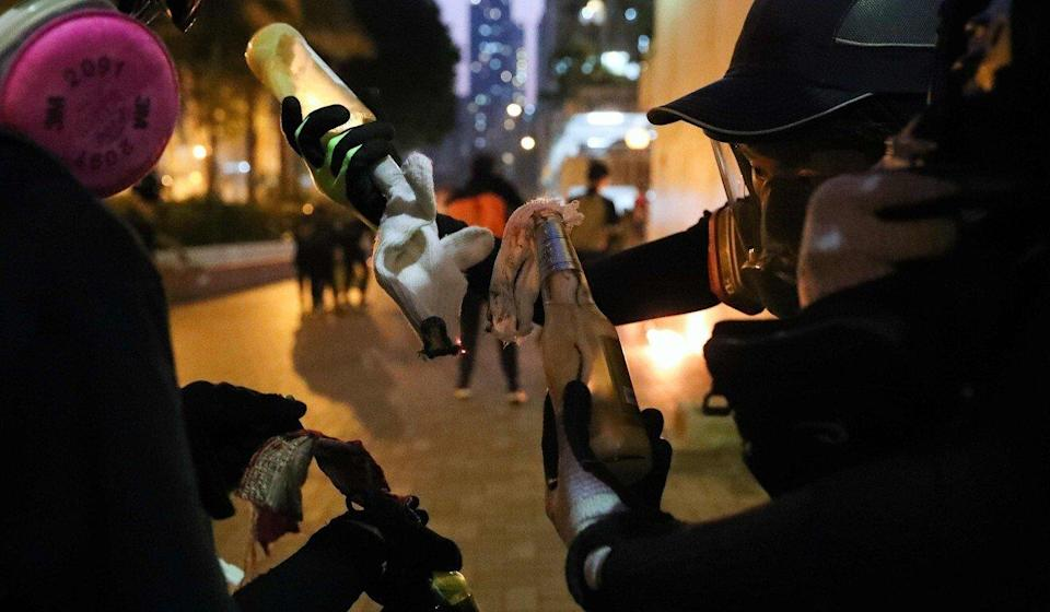 The petrol bomb landed 20 metres away from a police officer in Mong Kok, setting the ground on fire, without injuring anyone. Pictured are unrelated protesters on October 1, 2019. Photo: AFP
