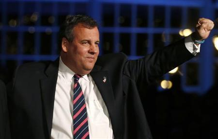 Republican New Jersey Governor Chris Christie waves to supporters at his election night party in Asbury Park, New Jersey