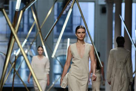 Models present creations from the Jason Wu Spring/Summer 2014 collection during New York Fashion Week