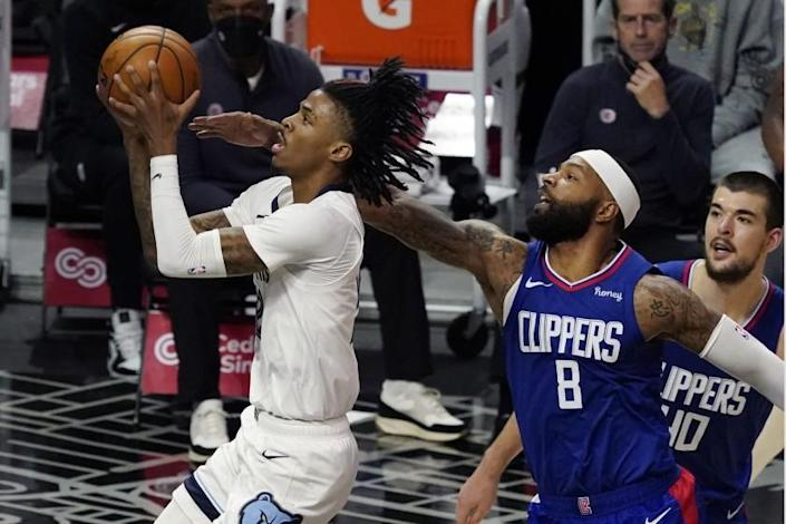 Memphis Grizzlies guard Ja Morant, left, drives past Los Angeles Clippers forward Marcus Morris Sr. (8) during the first half of an NBA basketball game Wednesday, April 21, 2021, in Los Angeles. (AP Photo/Marcio Jose Sanchez)