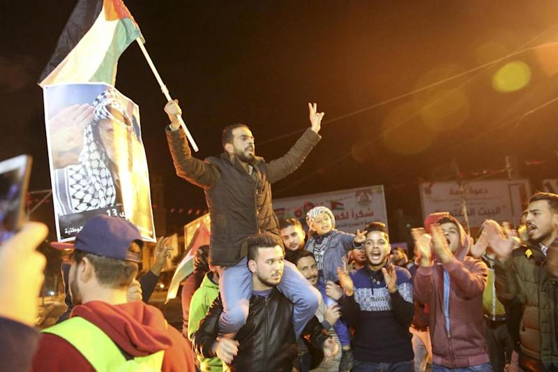 Palestinian protesters chant slogans during a rally in Gaza City on Wednesday night. (AP)