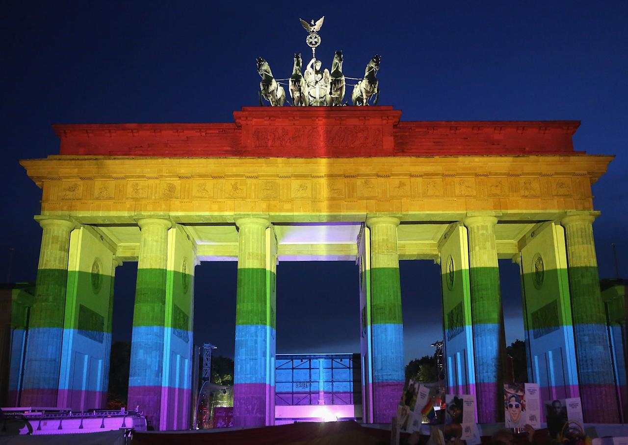 <p>The Brandenburg Gate is seen with a rainbow flag projected onto it during a vigil for victims of a shooting at a gay nightclub in Orlando, Florida nearly a week earlier, in front of the United States embassy on June 18, 2016 in Berlin, Germany. (Adam Berry/Getty Images) </p>