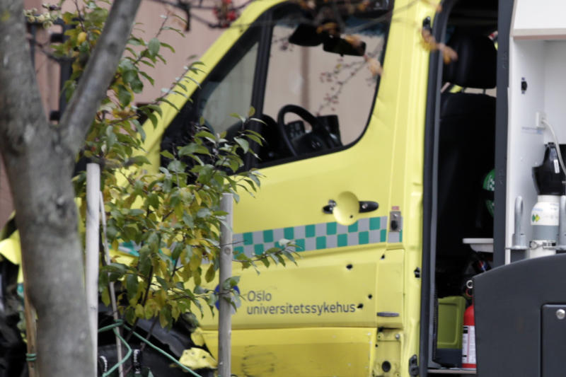 A damaged ambulance with bullet holes in the door is seen crashed into a building after an incident in the center of Oslo, Tuesday, Oct. 22, 2019. Norwegian police opened fire on an armed man who stole an ambulance in Oslo and reportedly ran down several people. (Stian Lysberg Solum/NTB scanpix via AP)