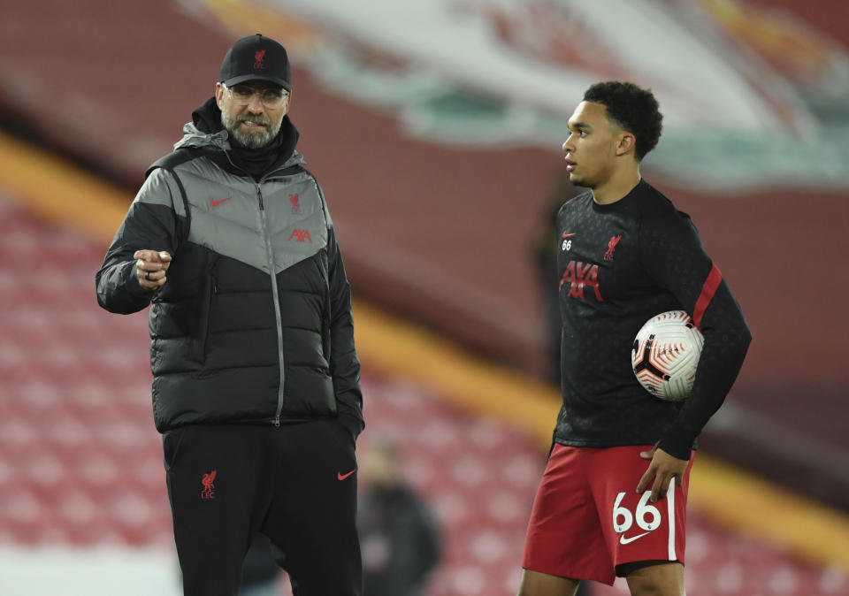 Trent Alexander-Arnold (right) is just one of a spate of Liverpool stars and starters who's injured right now. (Stu Forster/Pool via AP)