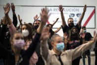 People take part in a protest to demand more resources for public health system and against social inequality in the southern neighbourhood of Vallecas in Madrid, Spain, Sunday, Sept. 27, 2020. Residents in a lockdown district of Madrid protested outside the Madrid Regional Government that local health services needed to be reinforced during the ongoing COVID-19 outbreak. (AP Photo/Manu Fernandez)