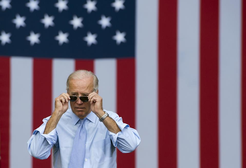 US Vice President Joe Biden takes his sunglasses off as he arrives for a campaign event with President Barack Obama at Strawbery Banke Field in Portsmouth, New Hampshire, on September 7, 2012.   AFP PHOTO / Saul LOEB (Photo by Saul LOEB / AFP) (Photo by SAUL LOEB/AFP via Getty Images)