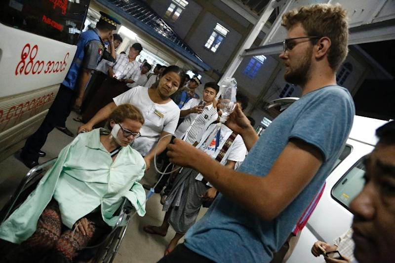 German tourist Wiebke Roesler (L), who was injured in a landmine explosion in Myanmar's northeastern Shan State, arrives at Mandalay hospital for treatment, on April 26, 2016 (AFP Photo/-)
