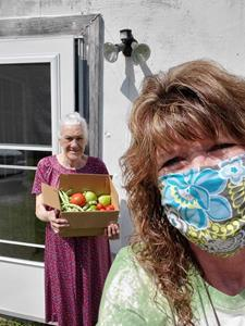 Renee Thomas had a porch visit with Bea and delivered food from the Grateful Bread Food Pantry and from her own home garden.