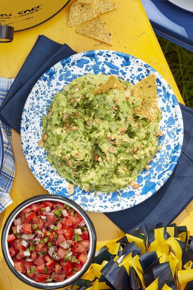 "<p>Trust us: Guac and chips make a <em>great</em> appetizer while guests are getting ready for the meal. Finish off this traditional avocado mixture with an additional sprinkle of toasted seeds, and serve with your favorite tortilla chips. For added flair (and flavor) mix it up the traditional way, in a Mexican granite mortar and pestle, called a molcajete.</p><p><strong><a href=""https://www.countryliving.com/food-drinks/a24275293/pepita-guacamole-recipe/"" rel=""nofollow noopener"" target=""_blank"" data-ylk=""slk:Get the recipe"" class=""link rapid-noclick-resp"">Get the recipe</a>.</strong></p><p><strong><a class=""link rapid-noclick-resp"" href=""https://www.amazon.com/Granite-Mortar-Pestle-Set-Molcajete/dp/B07DFG7BT3/?tag=syn-yahoo-20&ascsubtag=%5Bartid%7C10050.g.34473510%5Bsrc%7Cyahoo-us"" rel=""nofollow noopener"" target=""_blank"" data-ylk=""slk:SHOP MOLCAJETES"">SHOP MOLCAJETES</a><br></strong></p>"