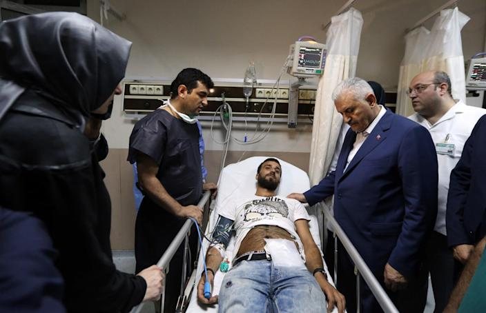 <p>Turkish Prime Minister Binali Yildirim, second right, visit a wounded man at a hospital in Istanbul, Wednesday, June 29, 2016. (Hakan Goktepe, Prime Ministry Press Office, Pool via AP) </p>