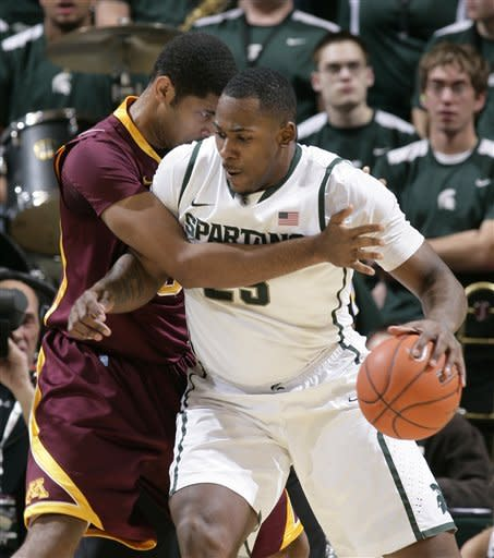 Michigan State's Derrick Nix, right, works under pressure from Minnesota's Ralph Sampson III during the first half of an NCAA college basketball game, Wednesday, Jan. 25, 2012, in East Lansing, Mich. (AP Photo/Al Goldis)