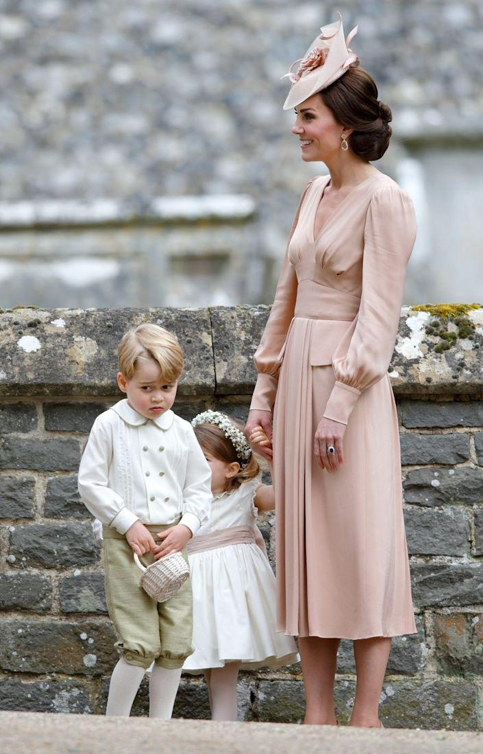 """<p>Prince George, looking sheepish here, <a href=""""https://www.townandcountrymag.com/society/tradition/g9536203/prince-william-harry-page-boys/"""" rel=""""nofollow noopener"""" target=""""_blank"""" data-ylk=""""slk:served as a pageboy"""" class=""""link rapid-noclick-resp"""">served as a pageboy</a> in his Aunt Pippa's wedding.</p><p><strong>Read More: </strong><a href=""""https://www.townandcountrymag.com/the-scene/weddings/g9899242/pippa-middleton-wedding-pictures/"""" rel=""""nofollow noopener"""" target=""""_blank"""" data-ylk=""""slk:See All the Best Photos from Pippa Middleton's Wedding"""" class=""""link rapid-noclick-resp"""">See All the Best Photos from Pippa Middleton's Wedding</a></p>"""
