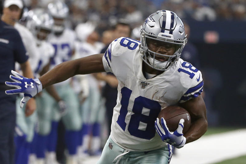 FILE - In this Sunday, Sept. 8, 2019, file photo, Dallas Cowboys wide receiver Randall Cobb (18) finds running room after catching a pass in the first half of a NFL football game against the New York Giants, in Arlington, Texas. Cobb still talks to his old quarterback regularly despite the receiver's move to the Dallas Cowboys after spending his first eight seasons with Aaron Rodgers and the Green Bay Packers. While Cobb hadn't spoken to Rodgers as of the middle of the week leading to their first game against each other Sunday, the trusty slot man didn't seem too hung up on avoiding contact.(AP Photo/Ron Jenkins, File)