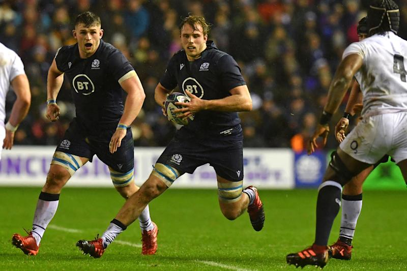 Scotland's lock Jonny Gray (C) makes a break during the Six Nations international rugby union match between Scotland and England at Murrayfield Stadium in Edinburgh on February 8, 2020. (Photo by Paul ELLIS / AFP) (Photo by PAUL ELLIS/AFP via Getty Images)
