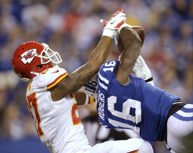 Indianapolis Colts' Da'Rick Rogers (16) makes a reception against Kansas City Chiefs' Sean Smith (27) during the second half of an NFL wild-card playoff football game Saturday, Jan. 4, 2014, in Indianapolis. (AP Photo/AJ Mast)