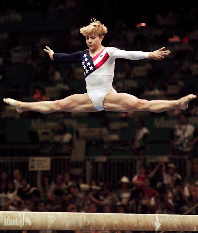Amanda Borden, of Cincinatti, Ohio, performs her routine on the balance beam during the women's team gymnastics competition at the Centennial Summer Olympic Games in Atlanta on Tuesday, July 23, 1996. (AP Photo/John Gaps III)