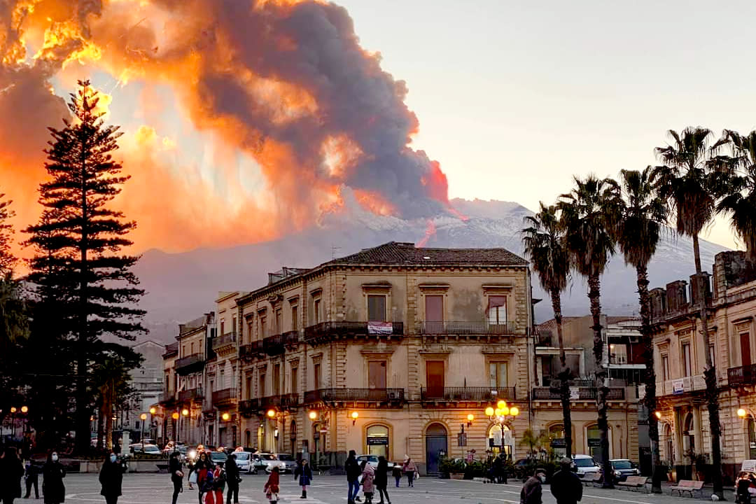 Mount Etna, Europe's most active volcano, spews ash and lava, as seen from Catania, southern Italy, Tuesday, Feb. 16, 2021. Mount Etna in Sicily, southern Italy,  has roared back into spectacular volcanic action, sending up plumes of ash and spewing lava. (Davide Anastasi/LaPresse via AP)