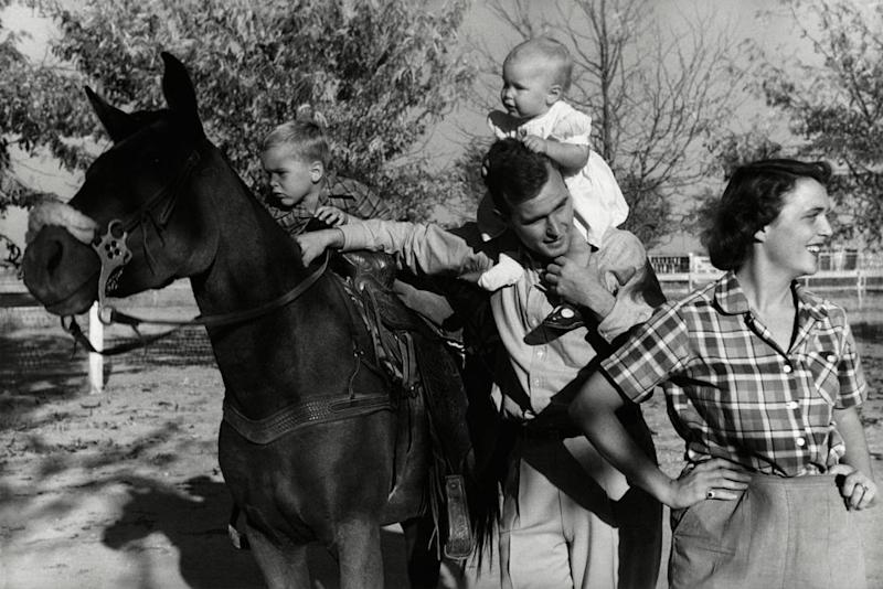 George H. W. Bush with his wife, Barbara, and their children Pauline (Robin) and George W. on horse in the yard of their Midlands, Texas ranch