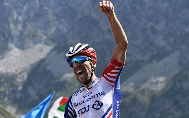 Thibaut Pinot punches the air in celebration after winning on the summit of the Tourmalet  - AFP or licensors