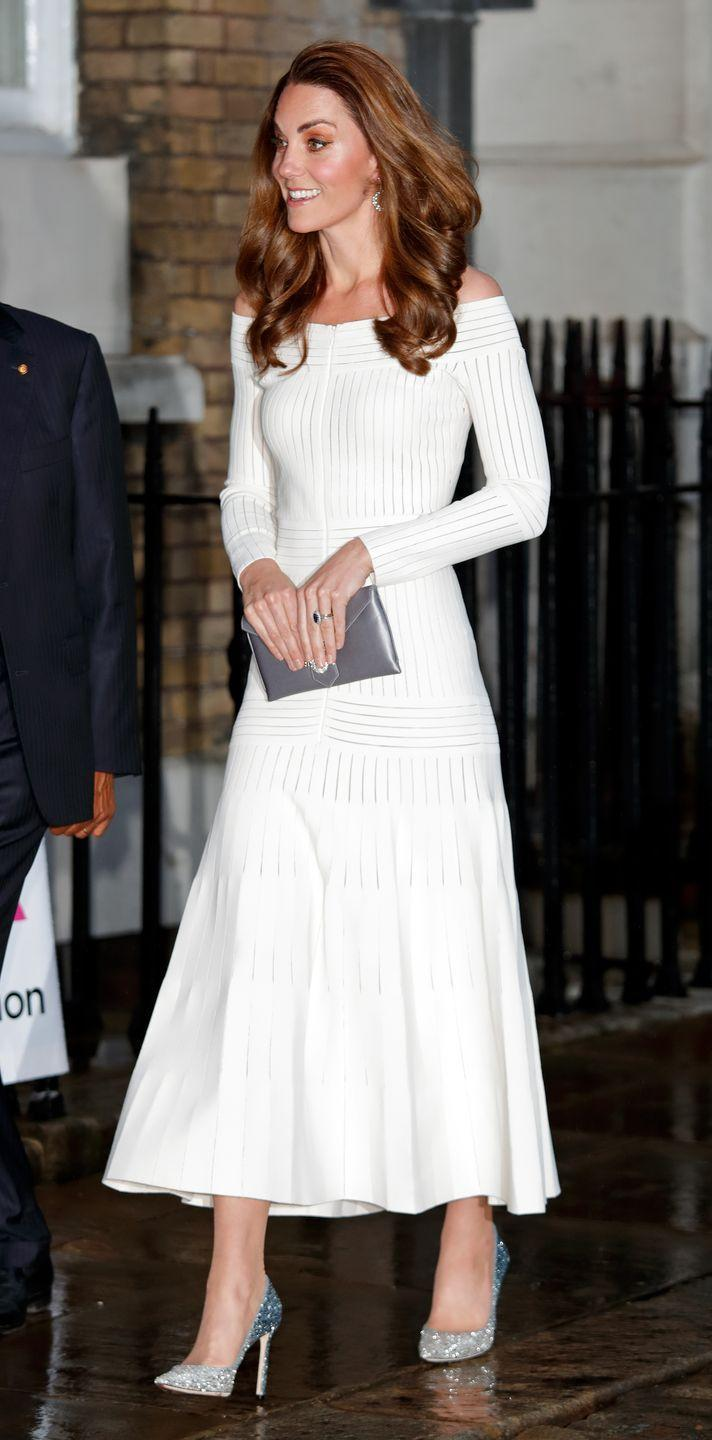 """<p>Kate Middleton rarely shows off her shoulders, as royals tend to <a href=""""https://www.thesun.co.uk/fabulous/11723966/meghan-kate-royal-dress-code-breakers/"""" rel=""""nofollow noopener"""" target=""""_blank"""" data-ylk=""""slk:shy away from bare shoulders"""" class=""""link rapid-noclick-resp"""">shy away from bare shoulders</a>. However, when the Duchess wants to wear a daring look, this white knitted <a href=""""https://www.harpersbazaar.com/celebrity/red-carpet-dresses/a27959939/kate-middleton-off-the-shoulder-dress-addiction-gala/"""" rel=""""nofollow noopener"""" target=""""_blank"""" data-ylk=""""slk:Barbara Casasola"""" class=""""link rapid-noclick-resp"""">Barbara Casasola</a> dress is her go-to. </p>"""