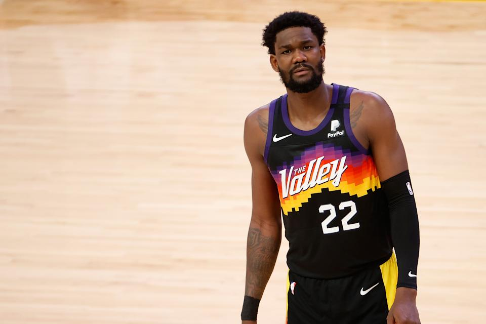 PHOENIX, ARIZONA - JULY 17:  Deandre Ayton #22 of the Phoenix Suns reacts in the first half of game five of the NBA Finals at Footprint Center on July 17, 2021 in Phoenix, Arizona.  NOTE TO USER: User expressly acknowledges and agrees that, by downloading and or using this photograph, User is consenting to the terms and conditions of the Getty Images License Agreement.  (Photo by Christian Petersen/Getty Images)