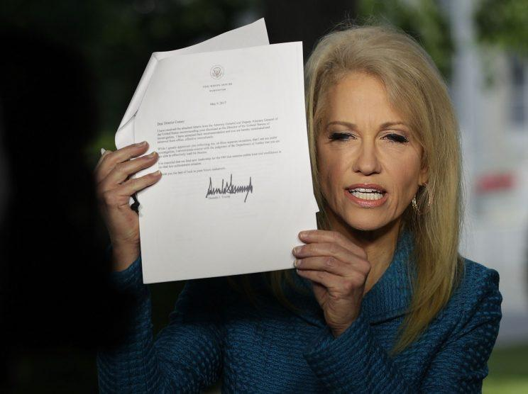During an interview with CNN on May 10, 2017, Kellyanne Conway holds up a copy of the termination letter that President Trump had sent to FBI Director James Comey. (Alex Wong/Getty Images)