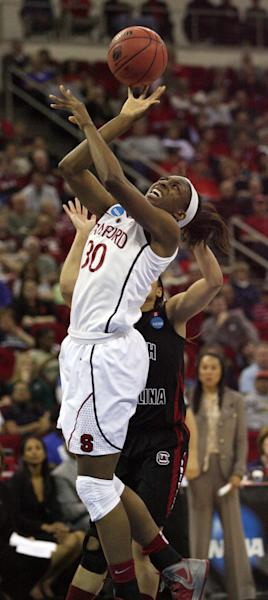 Stanford's Nnemkadi Ogwumike puts a shot up over a South Carolina defender in the first half of an NCAA women's tournament regional semifinal college basketball game Saturday, March 24, in Fresno, Calif. (AP Photo/Gary Kazanjian)