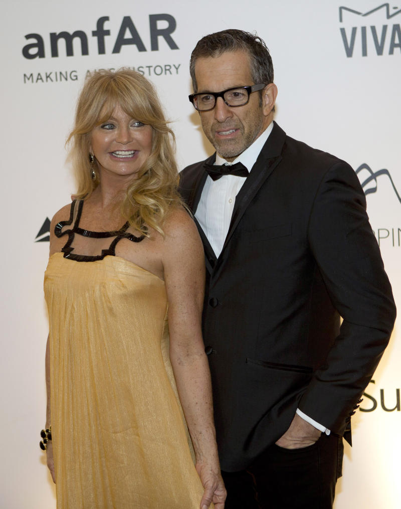 U.S. actress Goldie Hawn, left, poses for photos with U.S. designer Kenneth Cole as they arrive to a charity dinner for amfAR, a foundation for AIDS research in Rio de Janeiro, Brazil, Friday, Oct. 4, 2013. (AP Photo/Silvia Izquierdo)