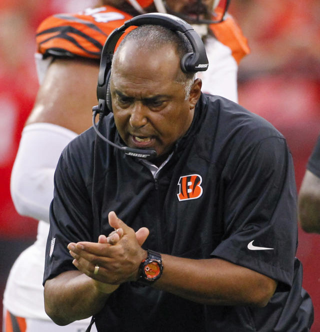 Cincinnati Bengals coach Marvin Lewis applauds during the first half of an NFL preseason football game against the Kansas City Chiefs on Thursday, Aug. 7, 2014, in Kansas City, Mo. (AP Photo/Colin E. Braley)