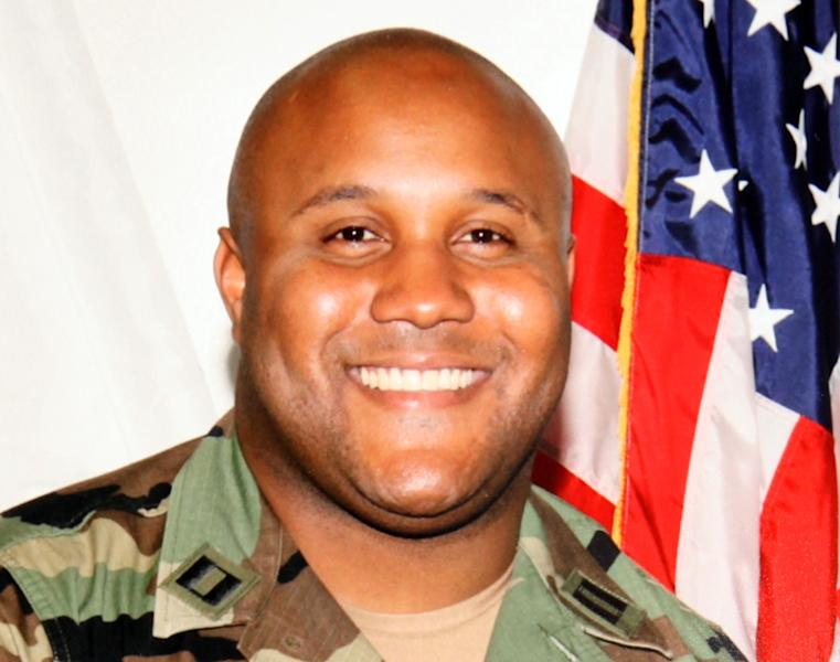 FILE - This undated file photo provided by the Los Angeles Police Department shows fugitive former Los Angeles police officer Christopher Dorner. Officials say the burned remains found in a California mountain cabin have been positively identified as Dorner's. San Bernardino County Sheriff's spokeswoman Jodi Miller said Thursday, Feb. 14, 2013 that the identification was made through Dorner's dental records. (AP Photo/Los Angeles Police Department, File)