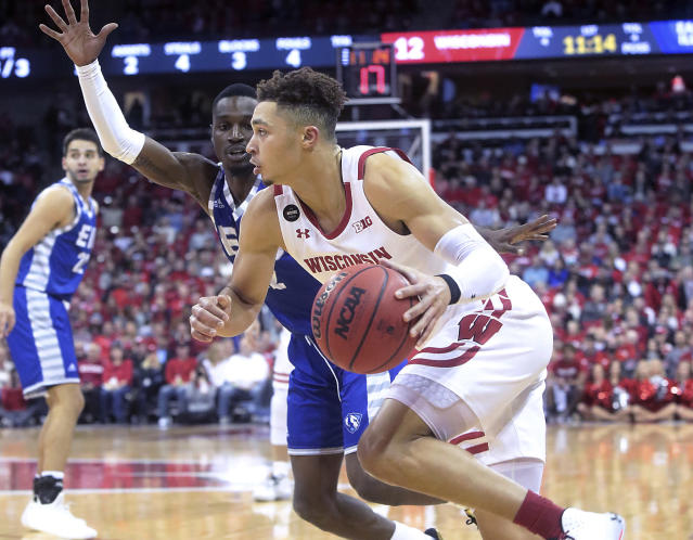 Wisconsin guard Kobe King (23) drives toward the basket during the first half of an NCAA college basketball game against Eastern Illinois in Madison, Wis., Friday, Nov. 8, 2019. (John Hart/Wisconsin State Journal via AP)