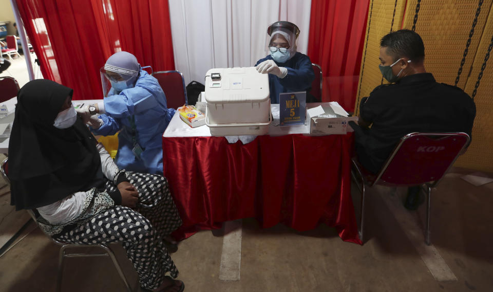 The AstraZeneca vaccine is administered during a vaccination campaign in Bekasi on the outskirts of Jakarta, Indonesia, Thursday, June 17, 2021. (AP Photo/Achmad Ibrahim)