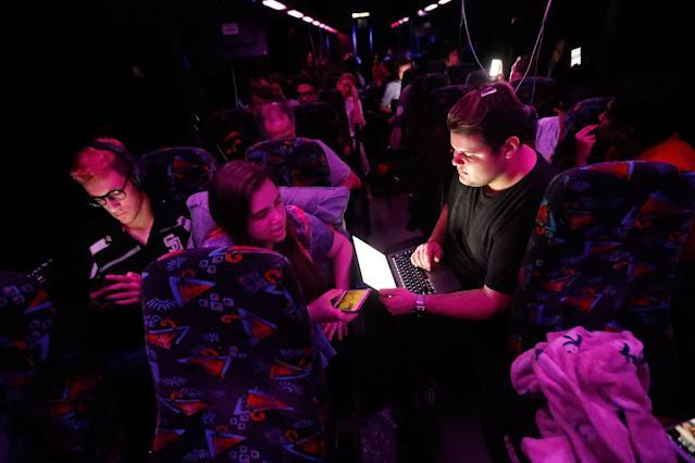 <p>Demitri Hoth, right, asks for feedback from Bailey Feuerman, on an open letter he is writing to legislators, as they and fellow student survivors from Marjory Stoneman Douglas High School, ride aboard their bus between Parkland, Fla., and Tallahassee, Fla., Tuesday, Feb. 20, 2018, to rally outside the state capitol and talk to legislators about gun control reform. (Photo: Gerald Herbert/AP) </p>