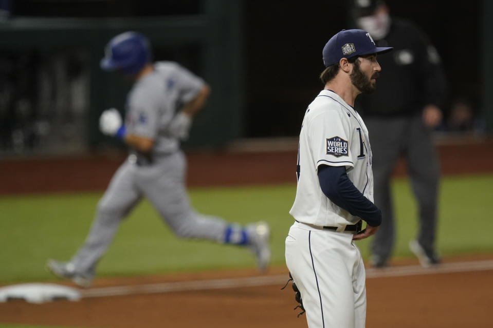 Los Angeles Dodgers' Austin Barnes rounds the bases after a home run off Tampa Bay Rays starting pitcher John Curtiss in Game 3 of the baseball World Series against the Tampa Bay Rays Friday, Oct. 23, 2020, in Arlington, Texas. (AP Photo/Eric Gay)