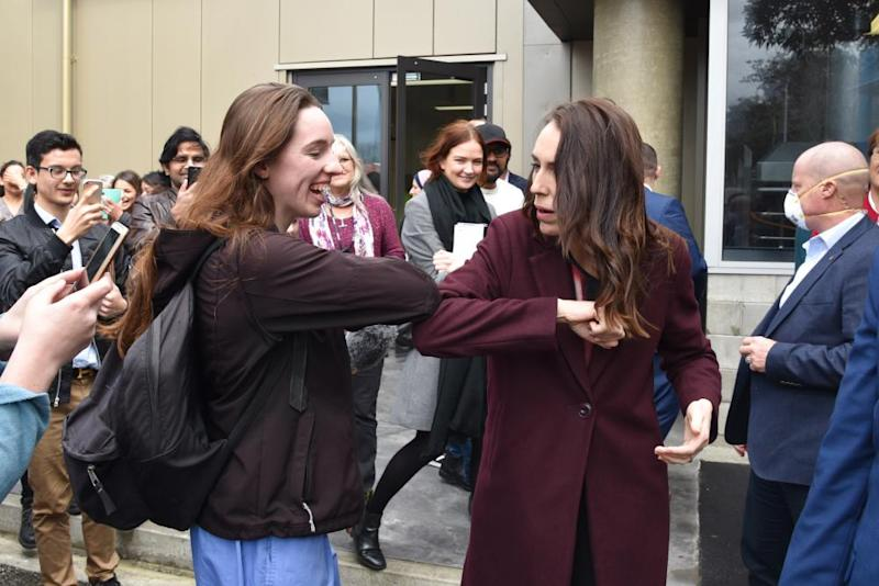 New Zealand Prime Minister Jacinda Ardern (R) greets a student at Massey University during election campaigning in Palmerston North.
