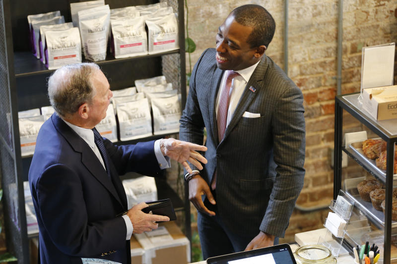 Democratic presidential candidate, former New York Mayor Michael Bloomberg, left, chats with Richmond mayor Levar Stoney at a coffee shop in Richmond, Va., Tuesday, Jan. 7, 2020. (AP Photo/Steve Helber)