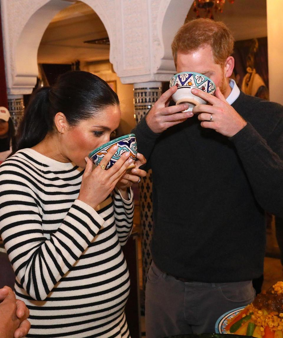<p>While at a cooking demonstration in Morocco in 2018, Prince Harry and a pregnant Meghan Markle proved that no one looks elegant while sipping from a big mug. The couple sampled a number of different cuisines throughout the day, which was part of their last tour before the birth of their son in May 2018. </p>
