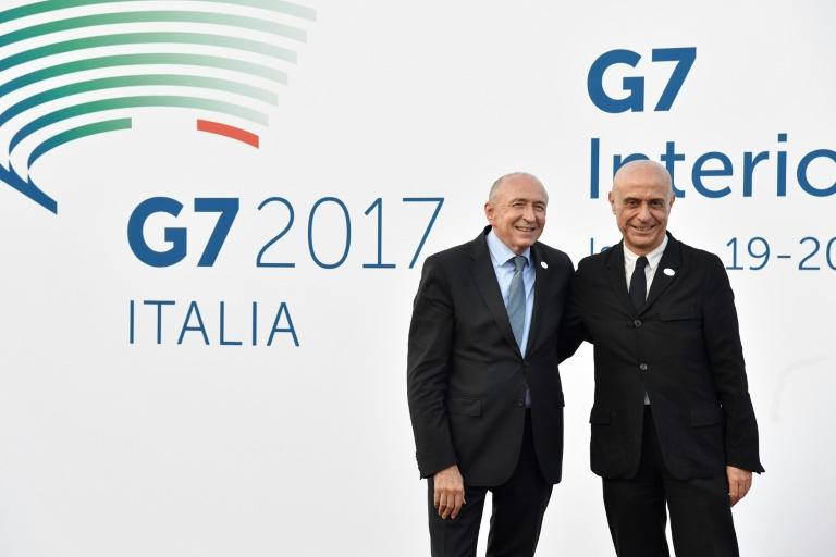 Italy's Interior Minister Marco Minniti (R) welcomes France's Interior Minister Gerard Collomb on October 19, 2017 for the G7 summit of Interior Ministers