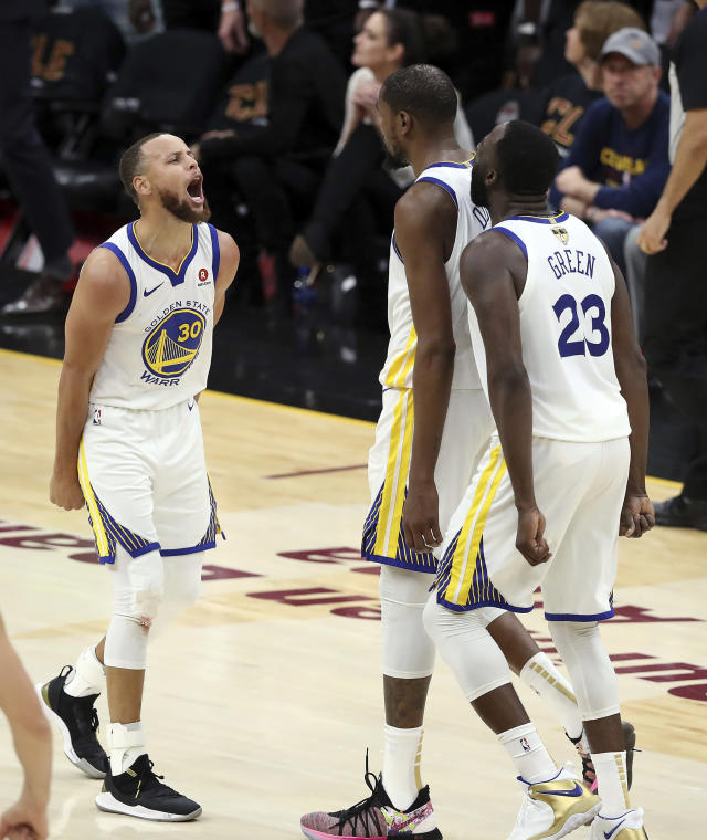 <p> Golden State Warriors' Kevin Durant celebrates with Stephen Curry, left, and Draymond Green (23) during the second half of Game 3 of basketball's NBA Finals against the Cleveland Cavaliers, Wednesday, June 6, 2018, in Cleveland. The Warriors defeated the Cavaliers 110-102 to take a 3-0 lead in the series. (AP Photo/Carlos Osorio) </p>