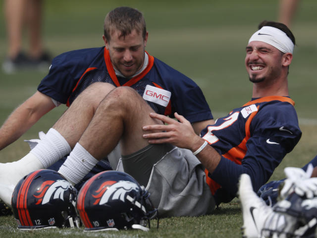 Case Keenum (L) has the No. 1 QB spot locked down in Denver, but things aren't so clear for Paxton Lynch. (AP)