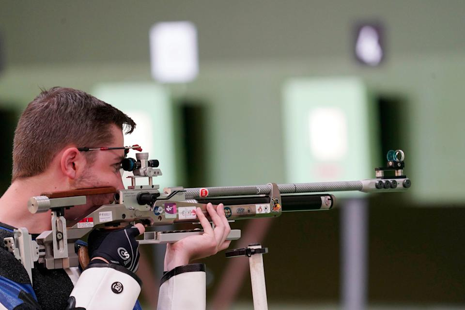 William Shaner competes in the men's 10-meter air rifle competition.